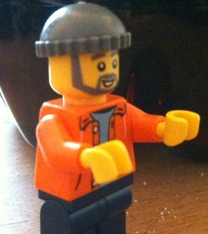 Minifigure with left hand rounded-side down, and right hand rounded-side up